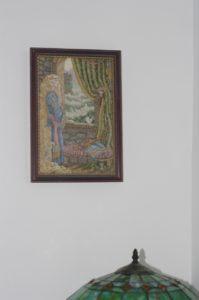 A mostly hidden picture by the side table, a Teresa Wentzler cross-stitch I of Rapunzel completed many years ago.