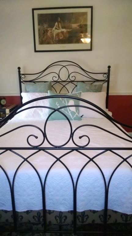 metal bedframe, from overstock.com  Simple white quilt, which after I put it on the bed I realized also had a fleur-de-lis in the quilt thread pattern.